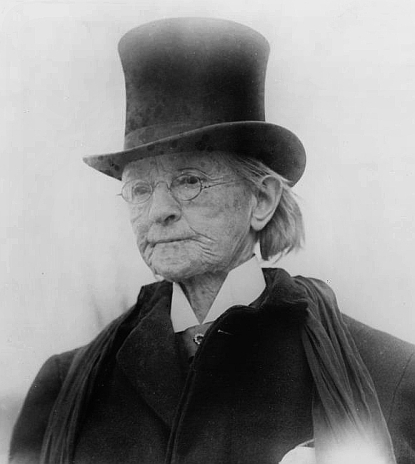 Walker in 1911 dressed in a man's top coat and hat.