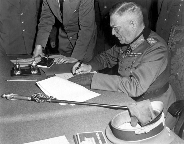 Generalfeldmarschall Wilhelm Keitel signing the ratified surrender terms for the German military in Berlin. (Wikimedia)