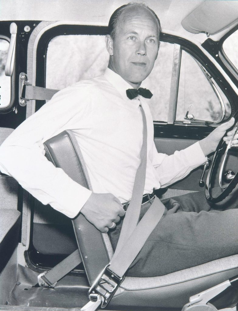 Engellau demonstrating the three-point seatbelt he commissioned.